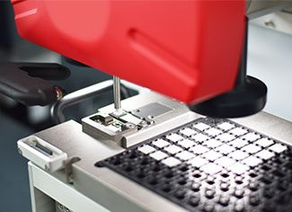 Pick and place waffle tray loader